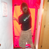 OurEvolution engineer conducting a blower door test on a park staff residence within the National Park.